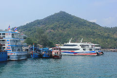 Boats take tourists to dive. April 8, 2014 tourist boats waiting to go snorkeling at Koh Tao, Surat Thani, Thailand stock photo