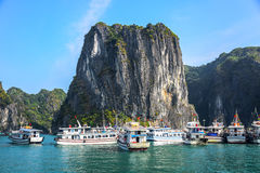 Boats for takin tourists to see limestone karsts and isles in Ha Long Bay, a very popular travel destination in Quang Ninh Stock Photos