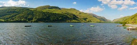 Tal-y-Llyn, Wales, UK. Boats on the Tal-y-Llyn in South Snowdonia, Gwynedd, Wales, UK - with Cadair Idris in the background Stock Photography