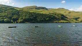 Tal-y-Llyn, Wales, UK. Boats on the Tal-y-Llyn in South Snowdonia, Gwynedd, Wales, UK - with Cadair Idris in the background Royalty Free Stock Photography