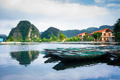 Boats in Tam Coc wharf Royalty Free Stock Image
