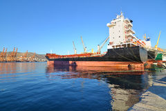 Boats and tanker at the industrial area of Drapetsona Greece Royalty Free Stock Photos