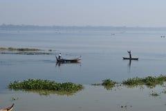Boats in Taungthaman Lake, Amarapura, Mandalay, Myanmar. Boats crossing Taungthaman Lake, Amarapura, Mandalay, Myanmar Stock Images