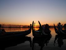 Boats at Taungthaman Lake near U Bein bridge in the sunset Royalty Free Stock Image