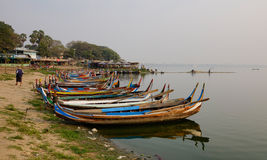 Boats on the Tauthungman lake in Mandalay, Myanmar Royalty Free Stock Photo