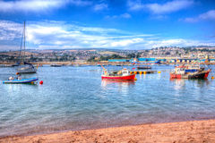 Boats on Teign river Teignmouth Devon with bright colourful blue sky HDR Stock Photography