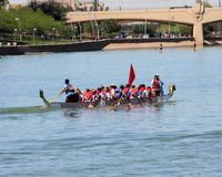 Boats on Tempe Town Lake during the Dragon Boat Festival. TEMPE, AZ/USA - MARCH 28: Unnamed members of an unnamed team paddle their boats at the Dragon Boat royalty free stock photo