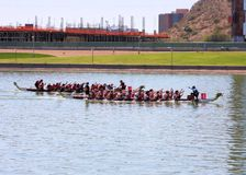 Boats on Tempe Town Lake during the Dragon Boat Festival. TEMPE, AZ/USA - MARCH 28: Unnamed members of an unnamed team paddle their boats at the Dragon Boat stock image