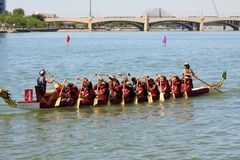 Boats on Tempe Town Lake during the Dragon Boat Festival. TEMPE, AZ/USA - MARCH 28: Unnamed members of an unnamed team paddle their boats at the Dragon Boat royalty free stock photography