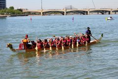 Boats on Tempe Town Lake during the Dragon Boat Festival. TEMPE, AZ/USA - MARCH 28: Unnamed members of an unnamed team paddle their boats at the Dragon Boat stock photo