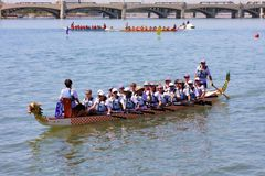 Boats on Tempe Town Lake during the Dragon Boat Festival. TEMPE, AZ/USA - MARCH 28: Unnamed members of an unnamed team paddle their boats at the Dragon Boat stock photography