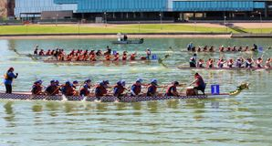 Boats on Tempe Town Lake during the Dragon Boat Festival. TEMPE, AZ/USA - MARCH 28: Unnamed members of an unnamed team paddle their boats at the Dragon Boat stock photos