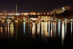 Boats at Termoli harbor by night. View of Termoli harbor by night (little city on the Adriatic sea in Italy royalty free stock photos
