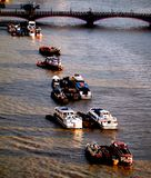 Boats on Thames River. Boats lined up at sunset on Thames River in London England Stock Images