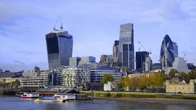 Boats on Thames river and London skyline Stock Photo