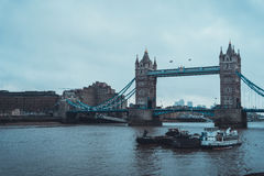 Boats on Thames River near Tower Bridge in London Royalty Free Stock Images