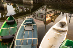 Boats. Three row boats on a tranquil canal Stock Photos