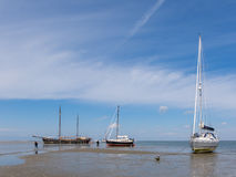 Boats on tidal flats of Wadden Sea Royalty Free Stock Image