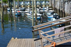 Boats tide up. At a pier royalty free stock image