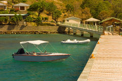 Boats tied at a new dock in the grenadines Royalty Free Stock Photography