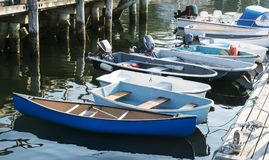 Boats tied to a dock in Maine stock photography