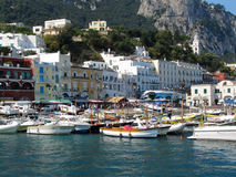 Boats Tied Up Alongside At  Marina Grande Port - Italy, Capri. Port of Capri Island in Summer Day, Italy, Tyrrhenian Sea, Gulf of Naples Royalty Free Stock Image