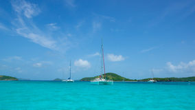 Boats in Tobago Cays. Cluster of boats float above the clear warm water of the Tobago Cays Royalty Free Stock Photography