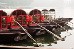 Boats for Tourists, Beihai Lake. Red boats lined up in the morning mist Stock Images