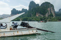 Boats and tourists at busy Railay bay Stock Photos