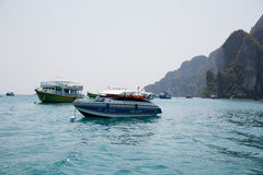 Boats with tourists diving in the Phi Phi Islands, Thailand Stock Images