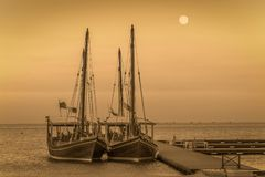 Boats traditional dhow in Arabic gulf. With sepia tone Stock Photo