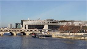 Boats traffic under Bercy bridge - Paris stock video footage