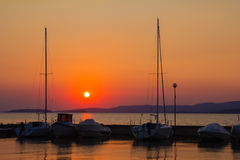 Boats in the Trasimeno lake at sunset. Umbria Royalty Free Stock Image