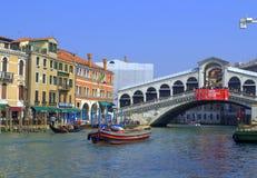 Boats travel under Rialto bridge Venice Royalty Free Stock Photography