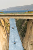 Boats travelling inside the isthmus of Corinth in Greece. Royalty Free Stock Photos