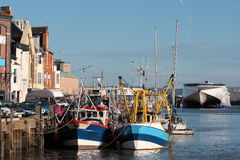 Boats and trawers in Weymouth harbour stock photography