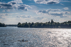 Boats with trees in a lake with clouds and blue sky. In Berlin, Germnay Stock Photo