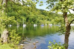 Boats and trees on Windermere Stock Photos