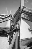 Boats on the trolley for launching. Yachts docked at the port of Malta. Boats on the trolley for launching on the water. Black and white picture Royalty Free Stock Images