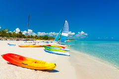 Boats on a tropical beach in Cuba stock images
