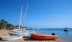 Boats on a tropical beach Stock Photography