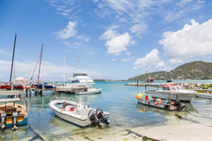 Boats in Tropical Harbor Stock Images
