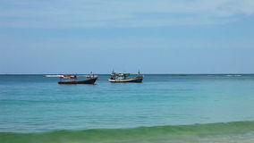 Boats in the tropical sea near tropical beach stock footage