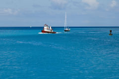 Boats in tropical waters Stock Photo