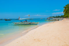 Boats at tropical white beach with sand beach of Panglao. Island, Bohol. Philippines. Boats at tropical white beach with sand beach of Panglao. Island, Bohol Stock Photos