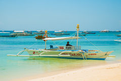 Boats at tropical white beach with sand beach of Panglao. Island, Bohol. Philippines. Boats at tropical white beach with sand beach of Panglao. Island, Bohol Stock Photo