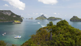 Boats in the Tropics. Speed boats travel through the turquoise waters around Angthong National Marine Park in southern Thailand Stock Images