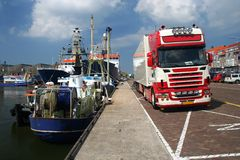 Boats and Truck. Harbour with boats and a truck on the quay stock images