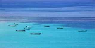 Boats at turquoise sea Royalty Free Stock Photo