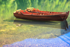 Boats. Two wooden boats on the river Lim Stock Images
